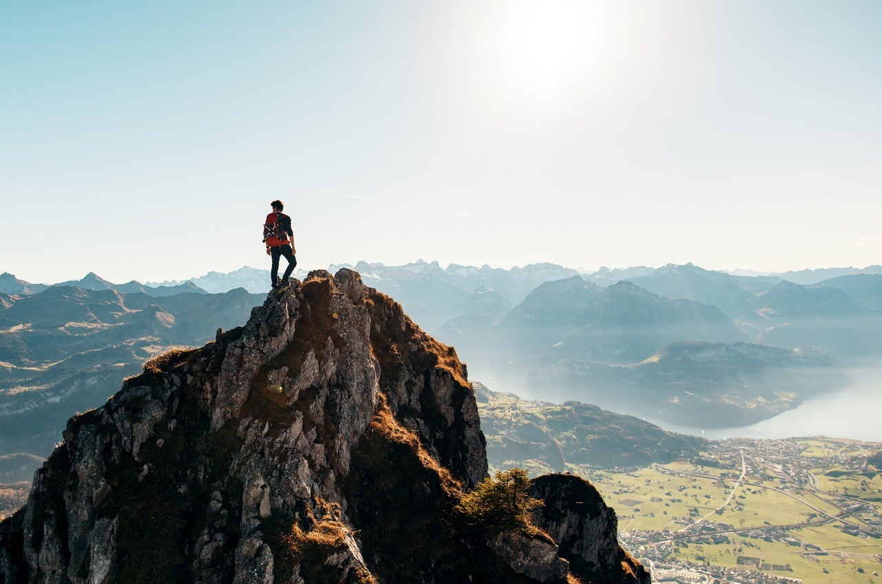 web developer standing on top of mountain