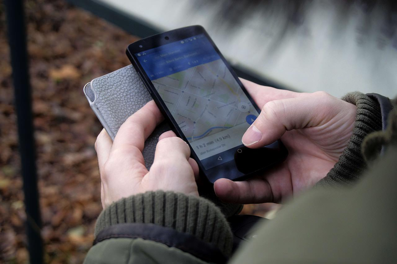 Person conducting a mobile search on Google Maps