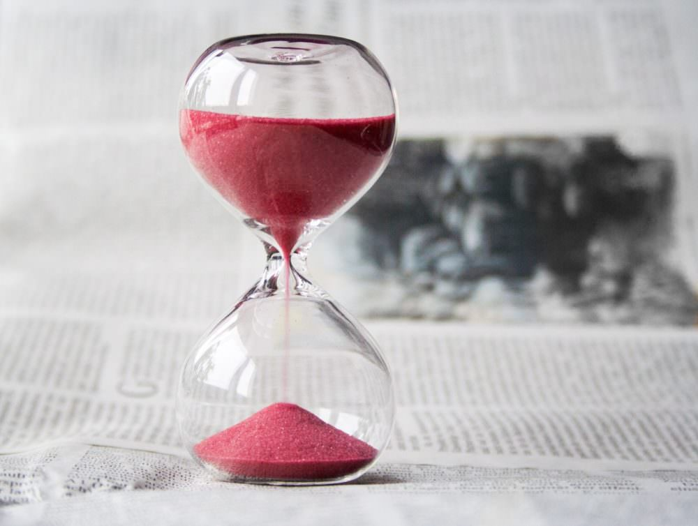 hourglass on newspaper