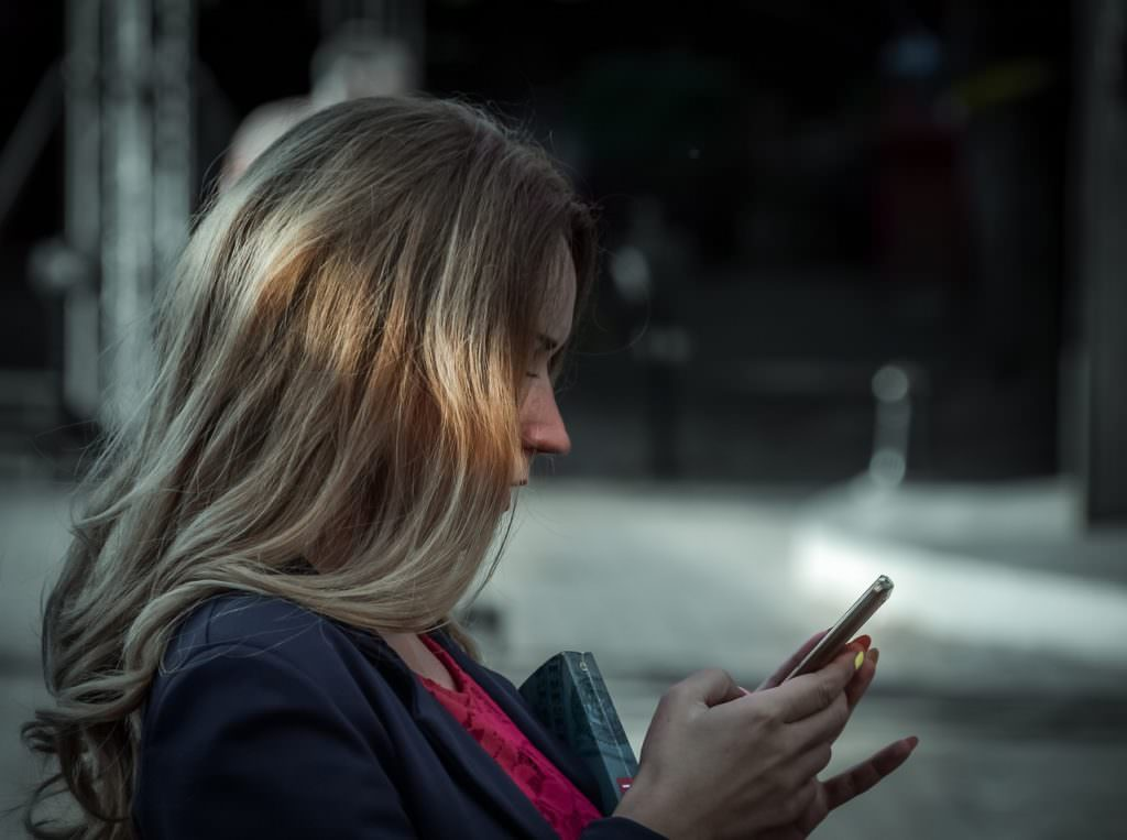 woman texting on her