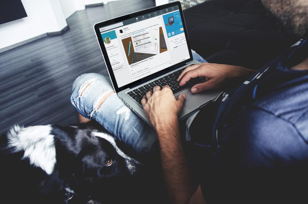 Man looking at a LinkedIn profile